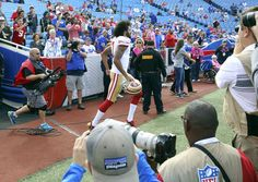 49ers vs. Bills:     October 16, 2016  -  45-16, Bills  -    San Francisco 49ers quarterback Colin Kaepernick (7) runs on the field for warm ups before an NFL football game against the Buffalo Bills on Sunday, Oct. 16, 2016, in Orchard Park, N.Y. (AP Photo/Bill Wippert)