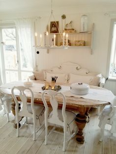 Dining Space - farmhouse table with a natural finish and a bench and mismatched chairs, all painted white - via Fabulous Senses: New start 2014!