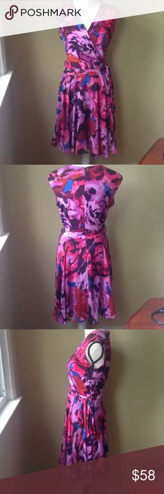 NWOT Taylor Floral Faux Wrap Dress Fun and class faux wrap dress from Lord and Taylor. There is a stain on the inside that will come out with a wash. Never worn besides to try on. Flirty and flattering fit! Thanks for looking! Happy poshing! Taylor Dresses Midi
