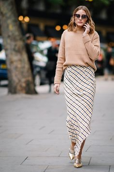 Olivia Palermo - A cozy sweater, plaid maxi and pointy metallic flats were the perfect fall combo for Olivia as she stepped out for London Fashion Week.