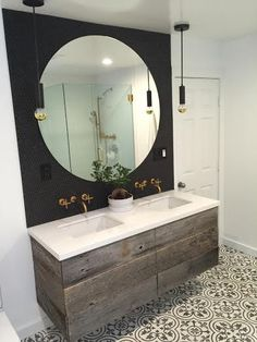 This bathroom  vanity was hand crafted using reclaimed oak barn boards. Our customer e-mailed us a few inspiration pics they liked for their bathroom remodel & we designed this double sink vanity.  Adds the perfect touch to complete their bathroom design!