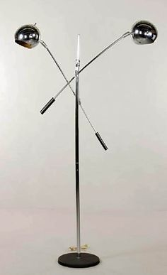 "MID C. CANTILEVER FLOOR LAMP Mid century modern Cantilever floor lamp, chrome, with two arms, 63"" x 41"" x 11 1/2"". (SOLD) http://www.kaminskiauctions.com/servlet/Search.do?auctionId=51&itemId=29848"