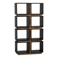 Symmetrical cubist grid finds perfect balance in a unique combination of rustic and refined woods. A striking two-tone, two-by-four arrangement presents eight open display compartments that can float to divide a room or live at the wall to frame its decor color. Reclaimed Brazilian peroba wood is inset to define the architectural facade and recessed at the base and each level all around to achieve a sense of lightness for a piece so substantial in scale. Rich ebony-stained mahogany veneer…