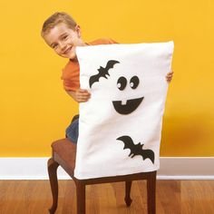 Halloween Ghost Chair Cover ~ This felt slip cover is the perfect backdrop for any season.  You can use repositionable glue on the shapes and switch them out for each season or holiday.  There's even a free template for the ghost