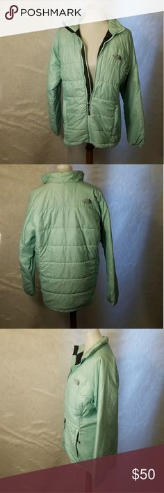 North face puffer jacket Light mint colored puffer jacket. Lightly worn. Zips all the way up the collar. 2 side pockets and hidden pocket on the front by the logo. Light puffy jacket. No known flaws or signs of wearing  Comes from a smoke and pet free home  Size: Large The North Face Jackets & Coats Puffers