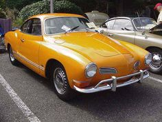 Orange Volkswagen Karmann Ghia Coupe My Dad had one like this, a work of art.