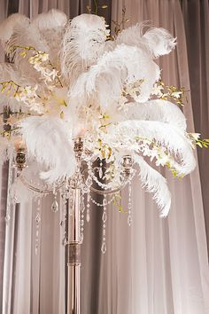 Feather & orchid centerpiece. So Hollywood glam!