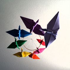 Rainbow Origami Crane Spiral Mobile by meligami on Etsy https://www.etsy.com/listing/182803159/rainbow-origami-crane-spiral-mobile