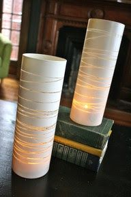 DIY. Take a glass vase, put rubber bands around it wherever you want, spray paint and when dry remove rubber bands.  How cool is that? #DIY, #reception