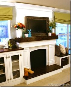 Like the dark wood cabinet tops with the mantle and TV frame...