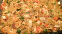 This is a seafood stuffing that has been in my family for a while. We have never actually stuffed the bird with this to avoid the turkey having a 'fishy' taste. We tend to like our dressing very moist, but if you prefer a drier stuffing, only use half of the broth.