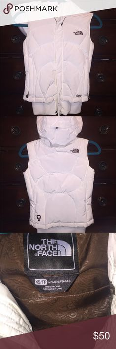 The North Face Hooded down Vest The north face hooded down vest with removable hood. Hidden zipper closure with Velcro flap over the main zipper. Inner iPod music pocket and headphones opening. Slimming fit. Good condition. Sorry no trades. The North Face Jackets & Coats Vests