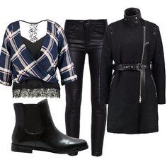 Questo outfit è adatto per le donne che hanno un animo rock. Il pantalone in similpelle come i bordi del cappotto e lo stivaletto chelsea sono abbinati ad una blusa dal sapore decisamente più romantico.