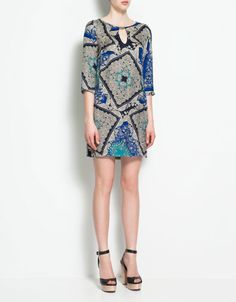 This appliqued dress by Zara, at the catch-it-while-it-lasts price of $59.90, is a piece of artwork unto itself. Dress it up or down with shoes and jewelry choices, and for a night out, nip in the waist with a delicate thin leather or scarf belt.
