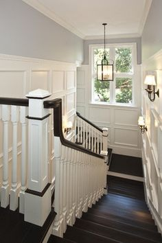 This is the color of my living room walls. Want to paint the handrail and stair treads just like this and do board and batten in a white like this. Painted Wood Stairs Design, Pictures, Remodel, Decor and Ideas Painted Wood Stairs, Wood Wall, Wooden Stairs, Blue Grey Walls, White Walls, Halls, Dark Wood Floors, Dark Hardwood, Rustic Floors