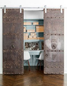 Rustic and antique sliding doors add uniqueness to the small home office [From: Robert Elliott Custom Homes / Nathan Schroder Photography] - March 05 2019 at Home Office Design, Home Office Decor, Home Interior Design, Home Decor, Office Ideas, Office Designs, Office Furniture, Barn Door Designs, Barn Style Doors