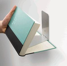 Awesome concealed bookshelf that makes it look as though the books are attached or floating against the wall!