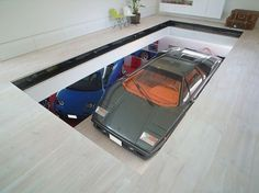 internal car lift to bring your favourite car (classic Lamborghini) up to your living room. KRE House Tokyo by Takuya Tsuchida