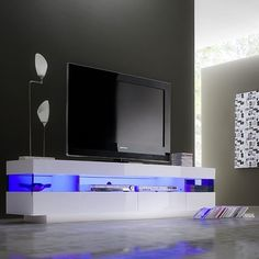 Tv entertainment unit ideas entertainment unit ideas 6 interior suggestions decorating small spaces with mirrors Wall Unit Designs, Tv Stand Designs, Tv Wall Design, Tv Entertainment Units, Living Room Entertainment Center, Tv Stand With Led Lights, High Gloss Tv Unit, White Tv Unit, Plasma Tv Stands
