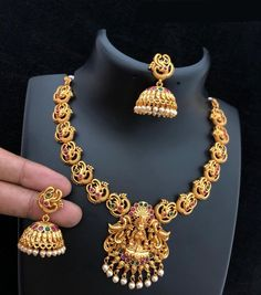 Laxmi goddess matte finish temple necklace comes with a pair of earrings. Style: Princess Cut Material: Brass with gold-coated, a matte finish Gold Temple Jewellery, Gold Wedding Jewelry, Gold Jewellery Design, Bridal Jewelry, Gold Jewelry, Gold Bangles, Jewellery Diy, Jewellery Earrings, Fashion Jewellery
