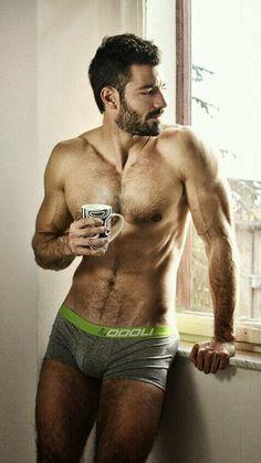 hairy man drinking coffee