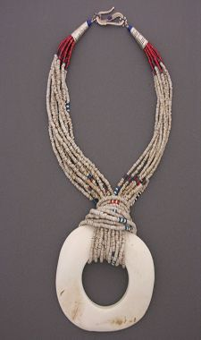 Adding a pendant with seed bead bail--also, like the pop of color with neutral colored beads