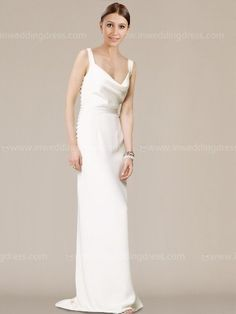 This slim, sleek column gown is the epitome of understated elegance. Crafted from luxurious satin, with a softly draped cowl at the neckline and back bodice. Fitted bodice. Side zip with self-covered buttons. Fully lined. Falls to floor with a slight train.