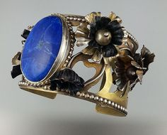 Nancy LT Hamilton.  Flower Cuff.  Chased and Repousse'd Flowers.  Brass, Bronze, Sterling, Fine Silver, Copper.  Dyed Howlite.