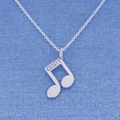 This cute and chic Sterling Silver Name Engraved Music Note Charm Pendant is the perfect gift for anytime of the year. Select any name or initials of your choice to be engraved on this special music note pendant, which is beautifully crafted by solid Sterling Silver hanging on the sturdy Rollo chain. This name engraved pendant in fine quality Sterling Silver is cut out by latest technology laser machine with top quality guaranteed and high polished finish. The chain is optional and all the…