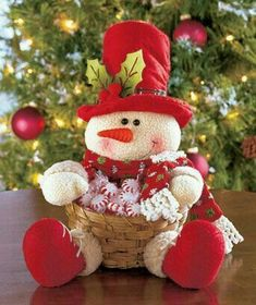 Plush Character Basket looks cute on tables, counters or buffets. He wears a holiday hat with holly and fabric accents and holds an attached bamboo basket that' Snowman Crafts, Diy And Crafts, Christmas Crafts, Christmas Decorations, Holiday Decor, Christmas Snowman, Christmas Stockings, Christmas Ornaments, Holiday Baskets
