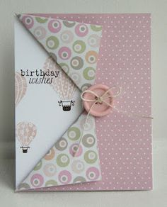 fun fold. I can really see this as a masculine card. Or a card for Christmas (opening a present) or new baby ( revealing our new sweet baby!)