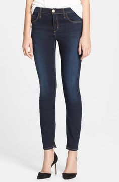 Pre-order this style from the Spring 2014 collection! Limited quantities. Ships as soon as available. You'll be charged only when your item ships. An Atlantic blue wash deepened by dimensional fading defines these go-to skinny jeans eased by slight vents at the ankle-length hems. Color(s): atlantic blue. Brand: McGuire. Style Name: McGuire Skinny Ankle Jeans. Style Number: 563263.