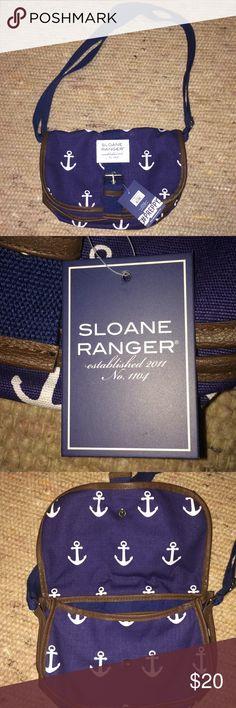 Sloane Ranger Saddle cross body bag Navy blue with white anchors, adjustable cross body strap, zipper pocket on the inside, magnetic front closure. Sloane Ranger Bags Satchels