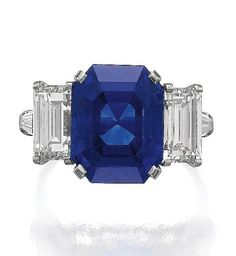 SAPPHIRE AND DIAMOND RING, BULGARI. Set with a step-cut sapphire weighing 10.59 carats, flanked between similarly-cut diamonds, to tapered baguette diamond shoulders, size 52, signed Bulgari.