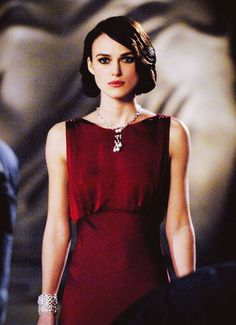 Keira Knightley for Coco Mademoiselle. Red chiffon, light weight silk, sleeveless dress.