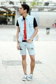 Shop this look on Lookastic:  https://lookastic.com/men/looks/light-blue-denim-gilet-red-and-black-crew-neck-t-shirt-light-blue-shorts-blue-low-top-sneakers/3470  — Light Blue Denim Gilet  — Light Blue Denim Shorts  — Blue Low Top Sneakers  — Red and Black Print Crew-neck T-shirt