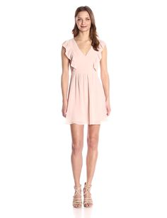 fee1ab42c151 A graceful blush ruffle dress you can slip on for a flawless transition  from answering emails to attending client dinners.