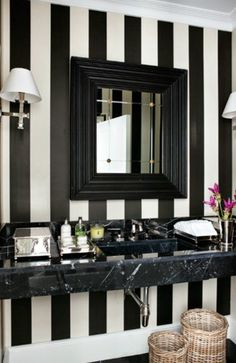 Black And White Striped Bathroom Wallpaper, Polished Nickel Sconces And  Woven Bathroom Baskets.