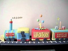 Fondant train cake for a little boy's first birthday - Happy Birthday Jake! I designed this cake and it's my first cake in about a year. It has hand made. Boys 1st Birthday Cake, Trains Birthday Party, Thomas Birthday, Train Party, Cakes For Boys, 1st Birthdays, Celebration Cakes, Themed Cakes, Desserts