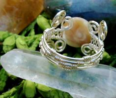 mother of pearl silver wire wrapped ring. wire by TheSeventhOak