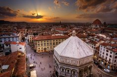 Piazza Del Duomo with the baptistry, as seen at sunset from Giotto's Campanile ( bell tower) Florence, Italy.