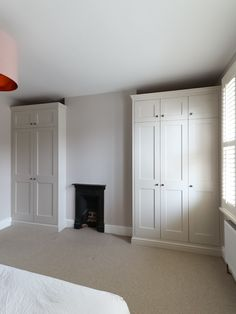 Alcove shaker wardrobes with oak internal drawers. Finished in farrow and ball 'skimmingstone'. Handmade by TW Bespoke in Burton on Trent. Alcove Wardrobe, Bedroom Alcove, Bedroom Built In Wardrobe, Painted Wardrobe, Oak Wardrobe, Bedroom Storage, Bedroom Ideas, Master Bedroom, Bedroom Paint Colors