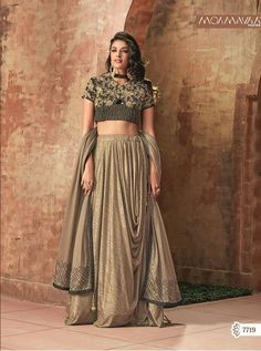 Buy Lovely Heavy Work Blouse Lehenga for Festival is High Neck Choli Lehenga. Brown and Black Crop Top Lehenga Choli with Thread,Sequins and cord embroidery. Choli Designs, Lehenga Designs, Blouse Designs, Lehenga Choli Online, Silk Lehenga, Dhoti Saree, Anarkali, Indian Bridal Wear, Indian Ethnic Wear