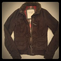 Jacket Very comfortable jacket! Plaid detailing on the inside, fur collar and buttons on the cuffs. I love this jacket but I have a newer one I wear more often now. Good condition! Abercrombie & Fitch Jackets & Coats