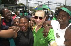 Edward Seaga, ex-prime minister and former leader of the Jamaica Labor Party, center, marches with residents in Spanish Town, in Kingston, Jamaica.