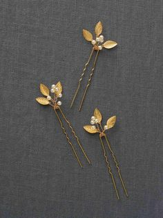 Adele Hairpin: Gold  Golden hairpins are handspun with tiny leaflets and pearls. These delicate hairpieces tuck beautifully into a goddess-inspired