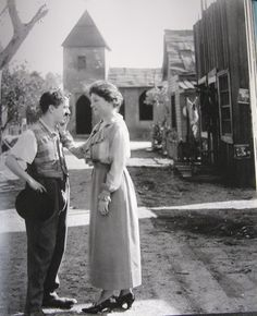 Charlie Chaplin and Helen Keller. I love this image.