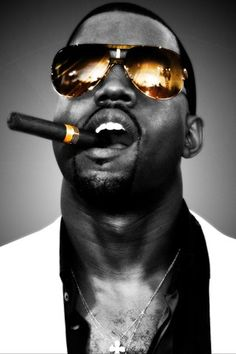 kanye west. The man of style and cultural impact. Even without the contrasting colours of his shades and cigars, the vertical sizing of the image just creates Kanye to be on top!