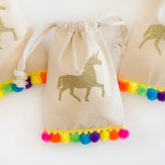 """Share the magic with your party guests and send them home with these adorable Unicorn party favor bags! Fill them with candy, tiny trinkets or small baked goods for the perfect party favor that your guests are sure to enjoy! Party bag size: 4"""" x 6"""""""