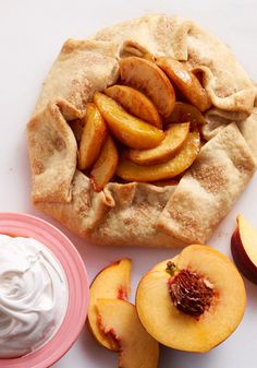 """Freestyle Peach Tart – Want in on the juicy truth? This delectable dessert recipe is almost too easy. Cinnamon, cream cheese, and fresh peaches bake up into a bubbly and sweet masterpiece that will make your family's tummy go """"Mmmm""""."""